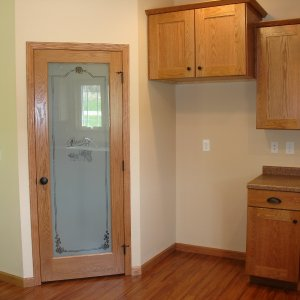New Model in Decorah, pantry door